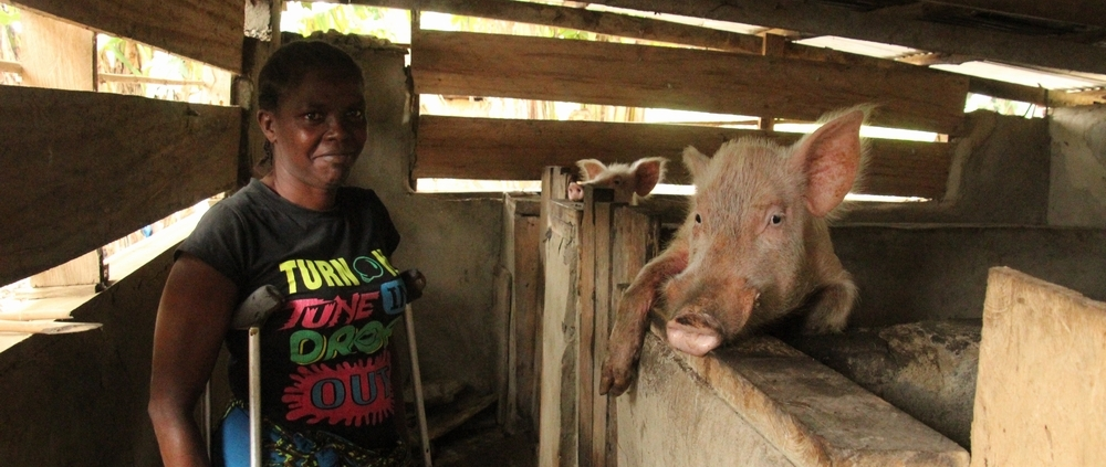 Martha Tokpa posed for photo at her piggery center in Wuo's Town, Nimba COunty